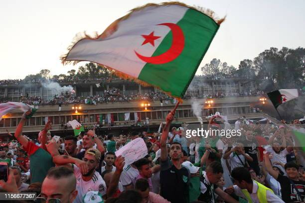 TOPSHOT Algerian fans celebrate after their team won the 2019 Africa Cup of Nations Final football match between Senegal and Algeria in Algiers on...