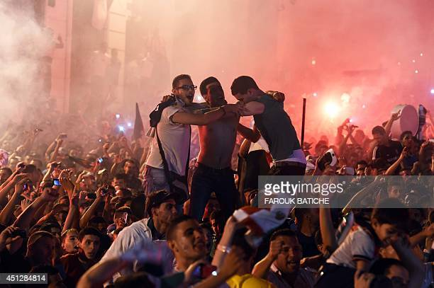 Algerian fans celebrate in Algiers on June 26 2014 after Algeria eliminated Russia with a 11 draw in a FIFA 2014 World Cup Group H match AFP...