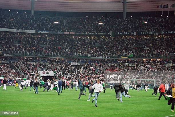 Algerian fans on field before the end of the friendly match between France and Algeria in the Stade de France. | Location: Saint-Denis, France.