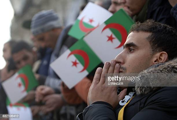Algerian fans react as they watch on a giant screen the Africa Cup of Nations football match between Tunisia and Algeria on January 19 in Algiers...