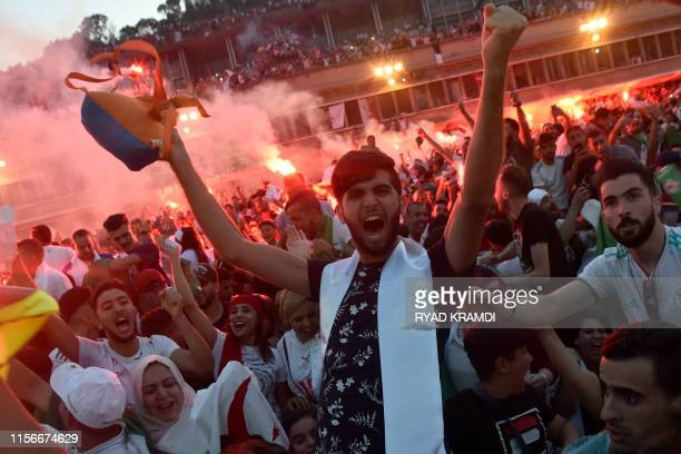 Algerian fans watch the 2019 Africa Cup of Nations Final football match between Senegal and Algeria, at the Ouagnouni Stadium in Algiers on July 19,...