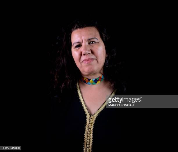 Algerian film director, producer and screenwriter Rahma Benhamou el Madani poses for a photo session in Ouagadougou, on February 24, 2019 during the...