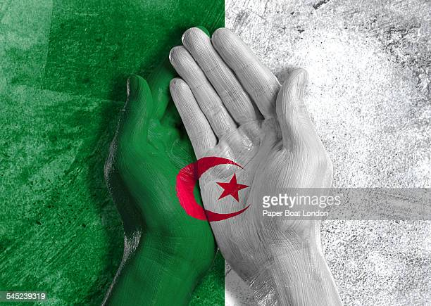 Algerian flag painted on two hands cupped together