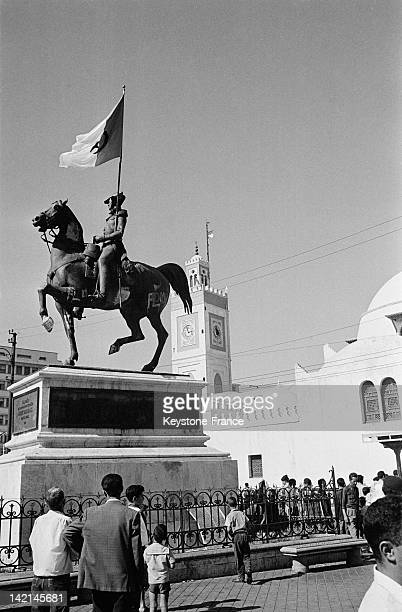 Algerian flags are everywhere in the streets of Algiers on the day after the independence even on the statue of the Duke of Orleans on July 4 1962 in...