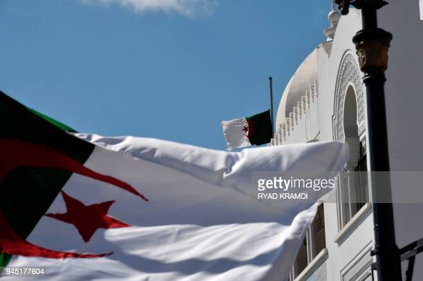 Algerian flags are seen at half mast in the capital Algiers on April 12 2018 after the president declared three days of national mourning over a...