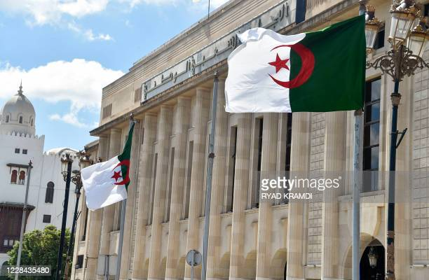 Algerian flags flutter in front of the People's National Assembly building in the capital Algiers, on September 10, 2020.