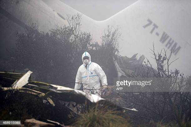 Algerian forensic experts inspect the wreckage of a C130 Hercules aircraft in the aftermath of a crash in Mount Fertas in the Oum El Bouaghi region...