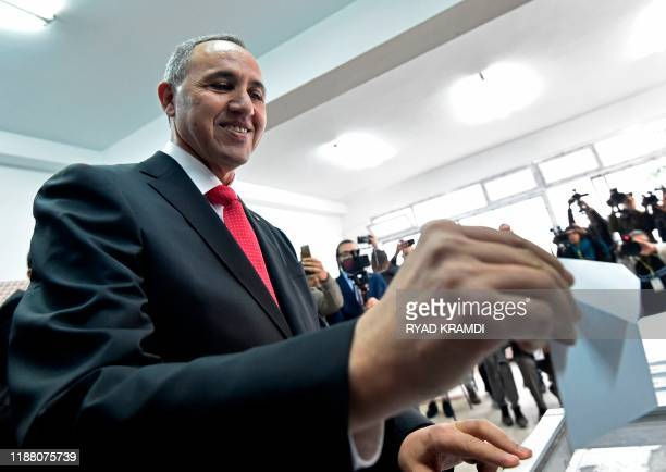 Algerian former culture minister Azzedine Mihoubi casts his vote during the presidential election on December 12 2019 at a polling station in Algiers...