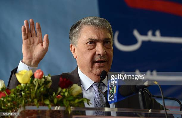 Algerian former premier and candidate for the presidential election, Ali Benflis gestures as he gives a speech during a campaign meeting on March 24,...