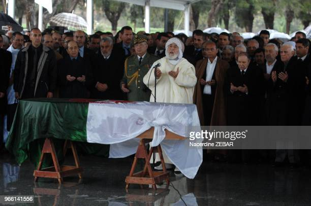 Algerian former President Chadli Bendjedid and current Abdelaziz Bouteflika Tunisian President Moncef Marzouki and other officials pray behind the...