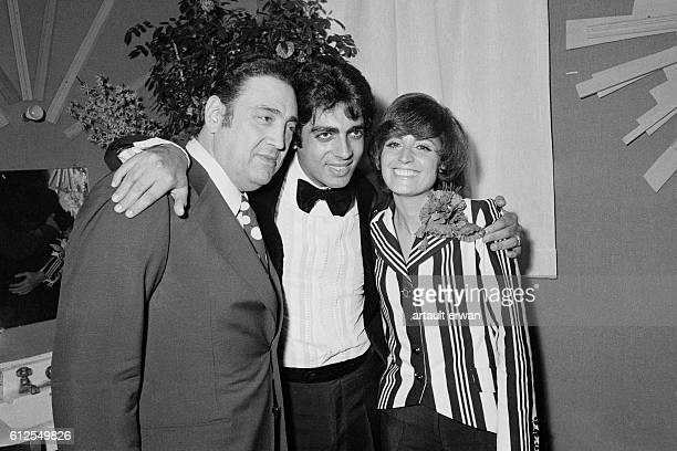 Algerian French Pied noir singer and songwriter Enrico Macias surrounded by his wife Suzy Leyris and his father Sylvain Ghrenassia in his dressing...