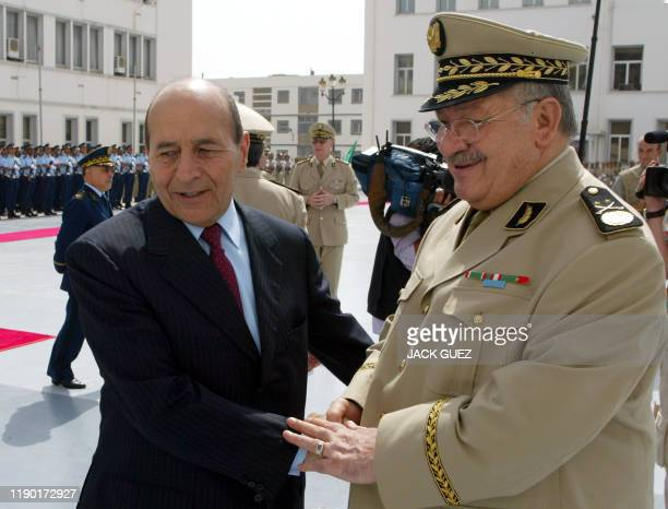 Algerian General Gaid Salah salutes Algerian Interior Minister Yazid Zerhouni 18 July 2004 at the Defense Ministry in Alger during the French defense...