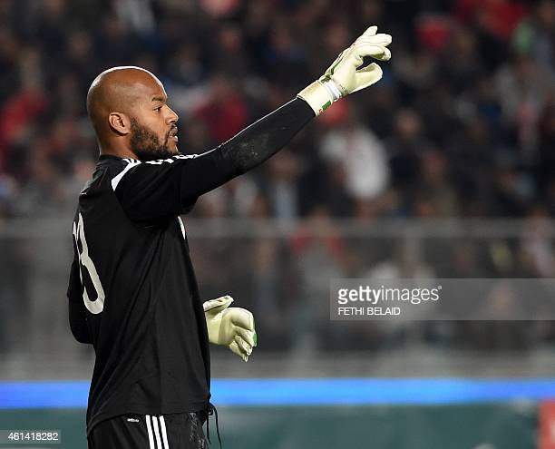 Algerian goalkeeper Rais Mbolhi reacts during a freindly soccer match between Tunisia and Algeria on January 11 2015 at Rades Olympic Stadium in...