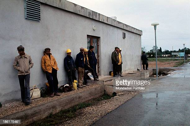 Algerian Immigrants wait for the bus after a days work Marseille 1974