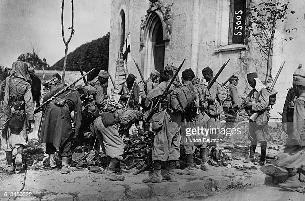 Algerian infantry inspect equipment captured from German forces during the Battle of the Marne of September 1914 French and British soldiers halted...