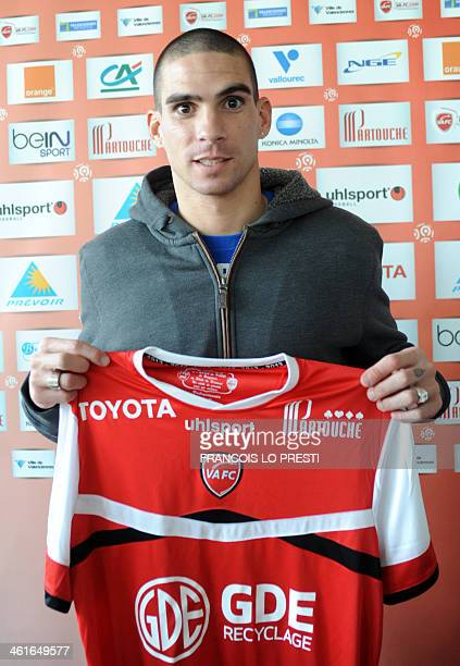 Algerian international defender Carl Medjani poses with his new shirt at his presentation on January 10 2014 after joining Valenciennes on loan from...