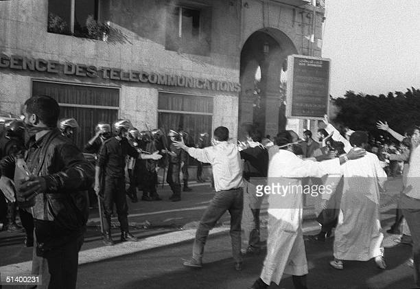 Algerian Islamic Salvation Front militants shout slogans to anti riot policemen during a demonstration in center Algiers in May 1991 BW ONLY