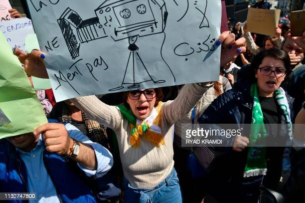 Algerian journalists take part in a demonstration against ailing President Abdelaziz Bouteflika outside the headquarters of the country's national...