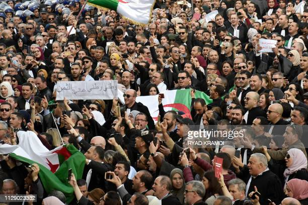 Algerian lawyers and journalists take part in a protest against their ailing president's bid for a fifth term in power in Algiers on March 7 2019 One...