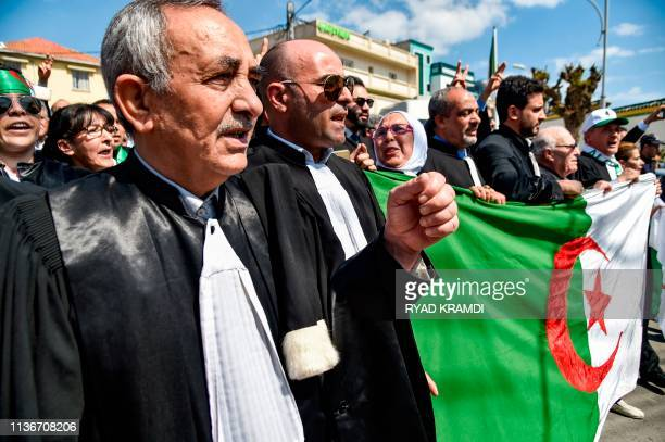 Algerian lawyers and judges chant slogans and raise a national flag as they gather for a demonstration for the independence of the judiciary outside...
