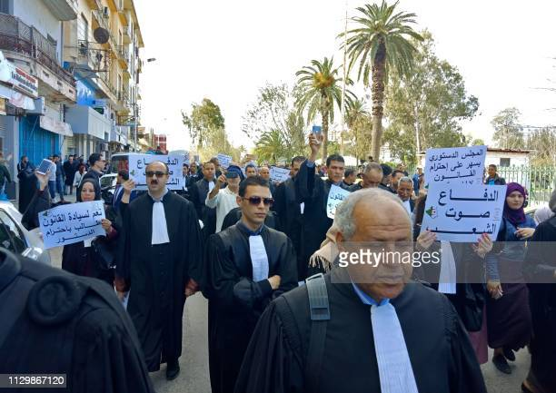 Algerian lawyers hold placards as they protest against their ailing president's bid for a fifth term in power in the northeastern city of Annaba on...