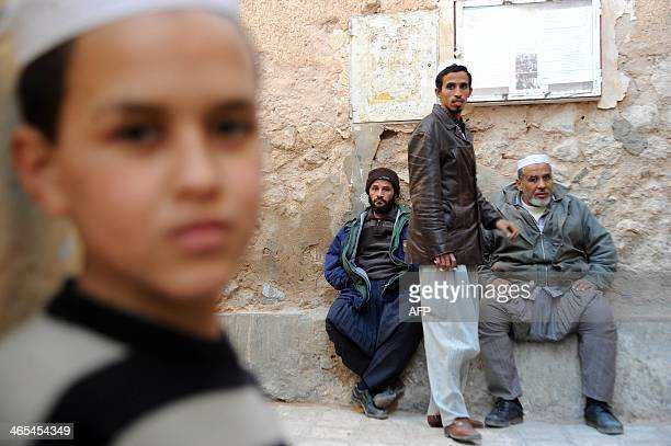 Algerian men from the Mozabites community a Berber minority group which adheres to the Ibadi faith an offshoot of Shiite Islam sit near closed shops...