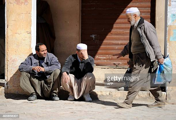 Algerian men from the Mozabites community a Berber minority group which adheres to the Ibadi faith an offshoot of Shiite Islam sit outside a closed...