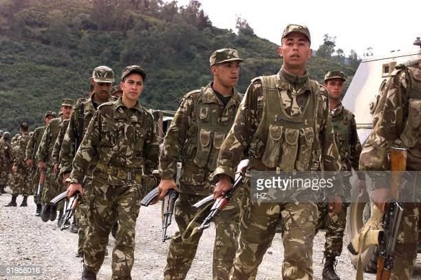 Algerian military are deployed in the mountainous region of Blida some 50km southwest of Algiers 28 March 2001 after Islamic extremists massacred 16...