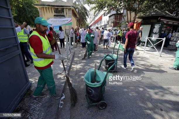 Algerian municipal workers and people cleared a neighborhood of Bab el oud residential after a cholera outbreak in Algiers Algeria August 30 2018