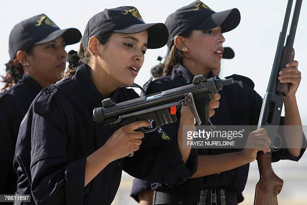 Algerian new graduated special unit police women perform during a graduation ceremony held at Police Academy in Ain Bonian in Algiers City 09...