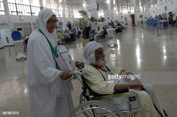 Algerian pilgrims arrive at Algiers airport on August 29 for their departure to the annual Hajj pilgrimage in the Islamic holy cities of Mecca and...
