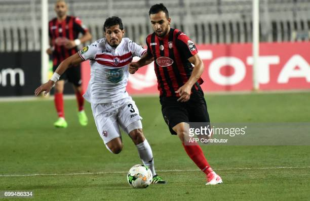 Algerian player Kaddour Bendjilali fights for the ball with Egyptian Tarek Hamed Elsaid Hamed during the CAF Champions League between USM Alger and...