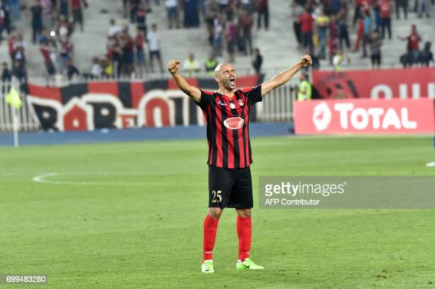 Algerian player Mokhtar Benmoussa celebrates the win after the end of the match of the CAF Champions League between USM Alger and Zamalek at the...