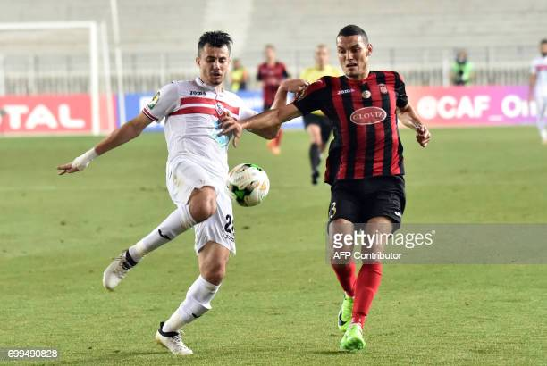 Algerian player Oussama Drafalou fights for the ball with Egyptian player Mahmoud Attia during the CAF Champions League between USM Alger and Zamalek...