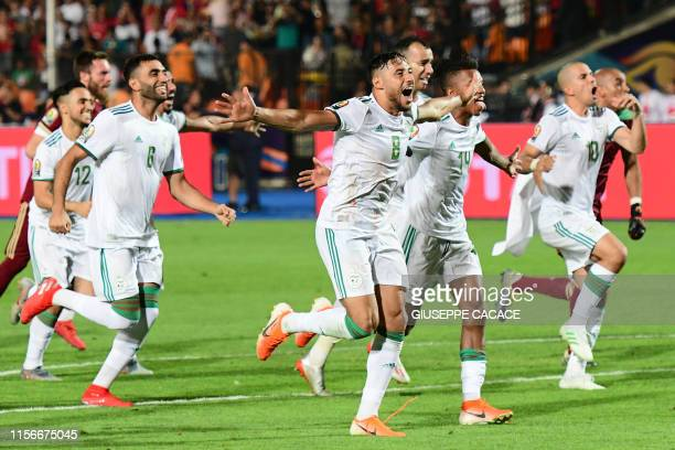 TOPSHOT Algerian players celebrate after winning the 2019 Africa Cup of Nations Final football match between Senegal and Algeria at the Cairo...