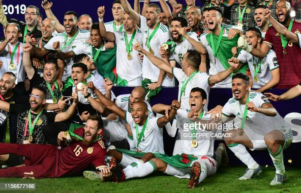 Algerian players celebrate after winning the 2019 Africa Cup of Nations Final football match between Senegal and Algeria at the Cairo International...
