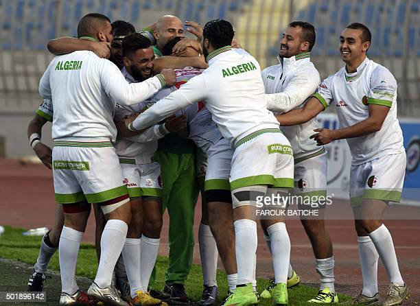 Algerian players celebrate scoring against Tunisia during their friendly rugby match Alegria's first international rugby match on home soil on...