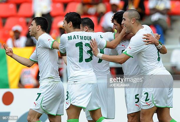 Algerian players celebrate their goal to 10 during the 2nd round qualifing match of the African Cup of Nations football championships CAN2010 between...
