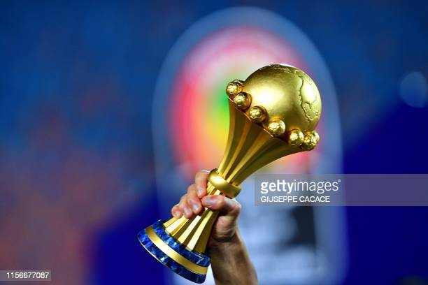 Algerian players celebrate with the trophy after winning the 2019 Africa Cup of Nations Final football match between Senegal and Algeria at the Cairo...