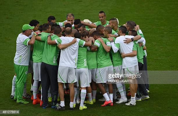 Algerian players form a huddle ahead of the Group H football match between Algeria and Russia at The Baixada Arena in Curitiba on June 26 during the...