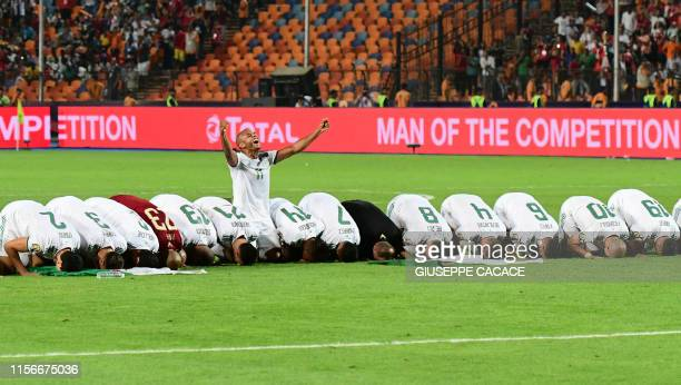 TOPSHOT Algerian players pray as they celebrate after winning the 2019 Africa Cup of Nations Final football match between Senegal and Algeria at the...