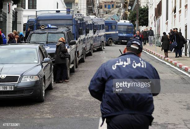 Algerian police are deployed in the street during a protest against Algerian President Abdelaziz Bouteflika running in the April presidential...