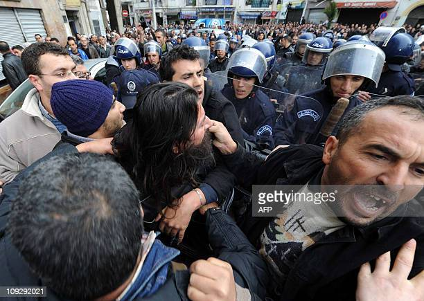 Algerian police push back demonstrators in Algiers on February 19 2011 About 200 Algerian protesters braved riot police to rally in a central square...