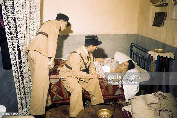 Algerian policemen look in on a women in the Casbah of Algiers Algeria Off limits to US servicemen and patrolled by Military Police French and...