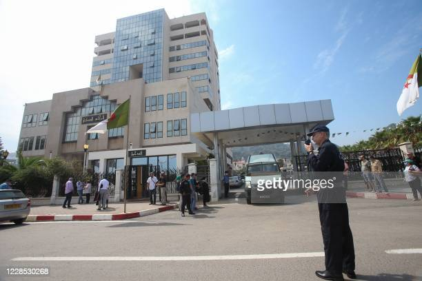 Algerian policemen stand guard outside the court in the capital Algiers on September 15 during the appeal of journalist Khaled Drareni. - Drareni was...
