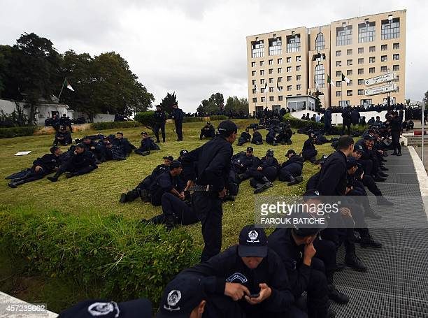 Algerian policemen take part in a public protest near the Presidential Palace in Algiers on October 15 supporting a police demonstration over working...