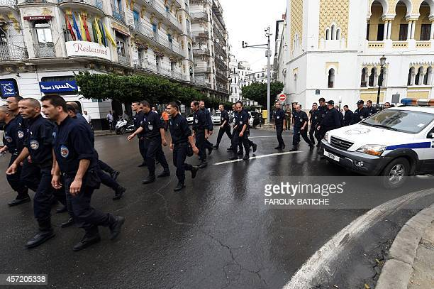 Algerian policemen take part in a public protest on October 14 2014 in Algiers in support with a police demonstration over working conditions and...