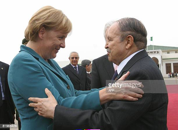 Algerian President Abdelaziz Bouteflika and German Chancellor Angela Merkel embrace at her departure at a presidential palace in Algiers on July 17...