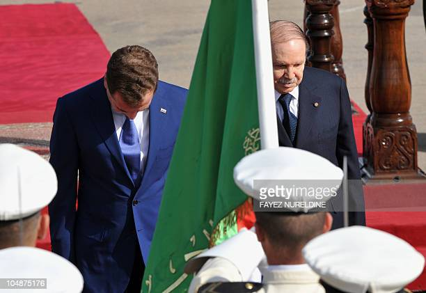 Algerian President Abdelaziz Bouteflika and his Russian counterpart Dmitry Medvedev pay their respect to the national flag during a welcoming...