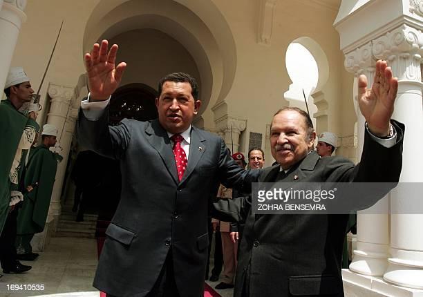 Algerian President Abdelaziz Bouteflika and his Venezuelian counterpart Hugo Chavez wave to journalists at Algiers presidential palace16 May 2006...